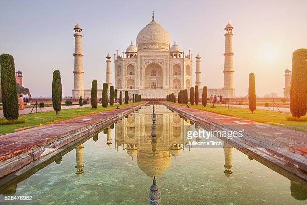 sunrise over taj mahal - taj mahal stock photos and pictures