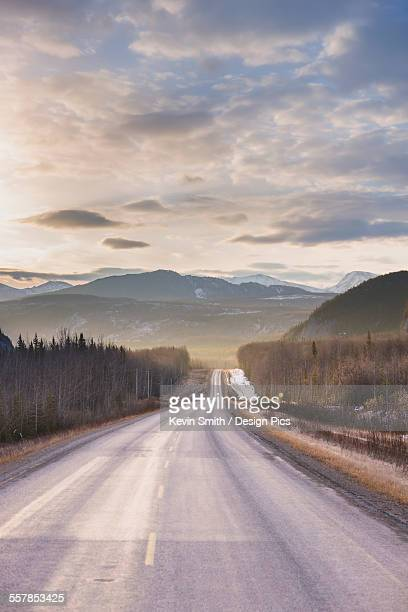 Sunrise over the alaska highway west of fort nelson, in the canadian rockies in early spring