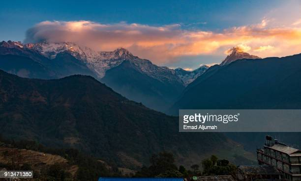 sunrise over the annapurna mountains range, nepal - march 2, 2017 - kathmandu stock pictures, royalty-free photos & images