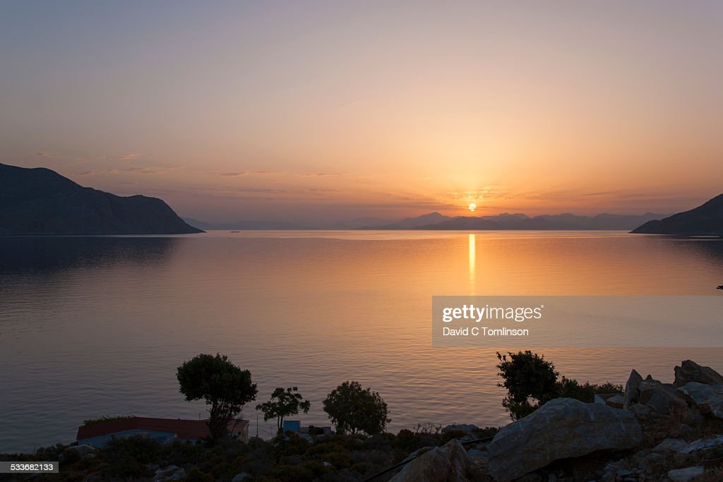 Sunrise over the bay, Nimborios, Symi, Greece : Foto stock