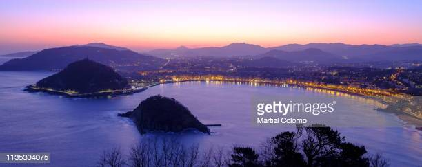 sunrise over the bay of donasti san sebastian - martial stock pictures, royalty-free photos & images
