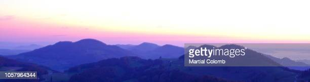 sunrise over the belchen mountains - twilight stock pictures, royalty-free photos & images