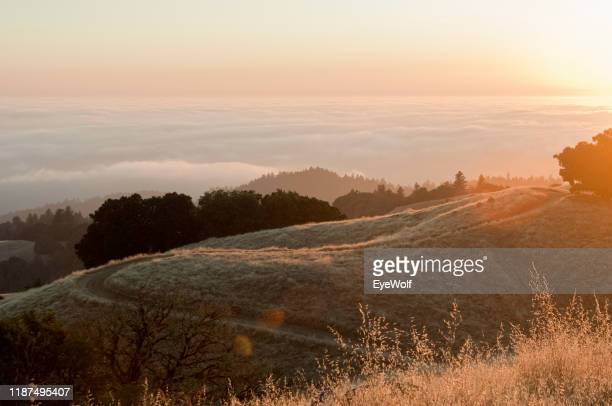 sunrise over the clouds up in the hills with a view of the horizon - santa clara county california stock pictures, royalty-free photos & images
