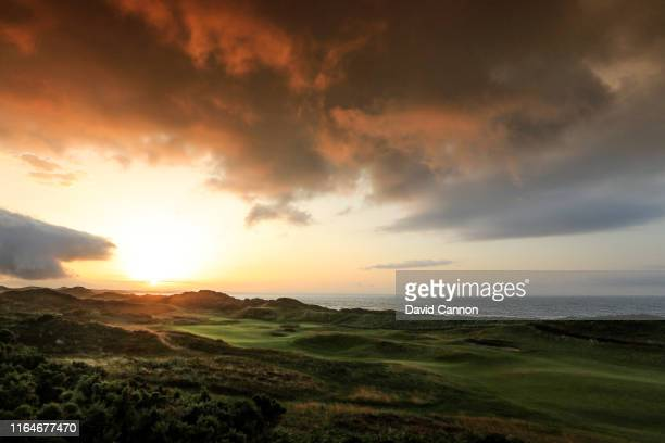Sunrise over the first green on the Championship Links at Royal County Down Golf Club on July 23 2019 in Newcastle Northern Ireland