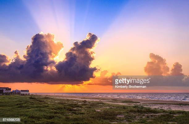 sunrise over the gulf of mexico - texas gulf coast stock photos and pictures