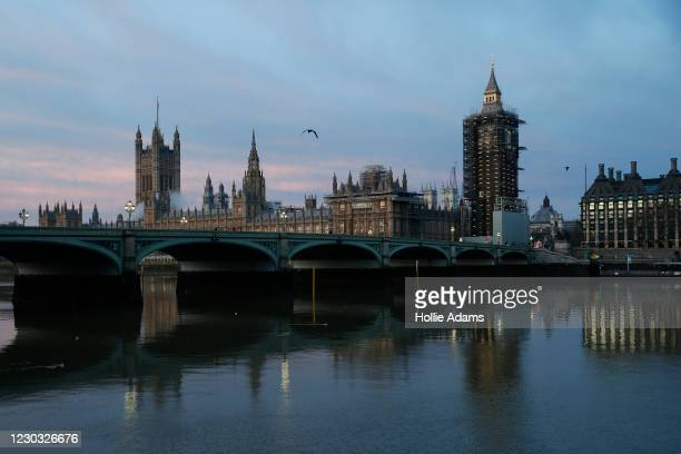 Sunrise over the Houses of Parliament on December 28, 2020 in London, United Kingdom. Last week, the British government scrapped a plan to allow...