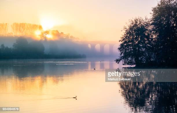 sunrise over the lake - bielefeld stock pictures, royalty-free photos & images