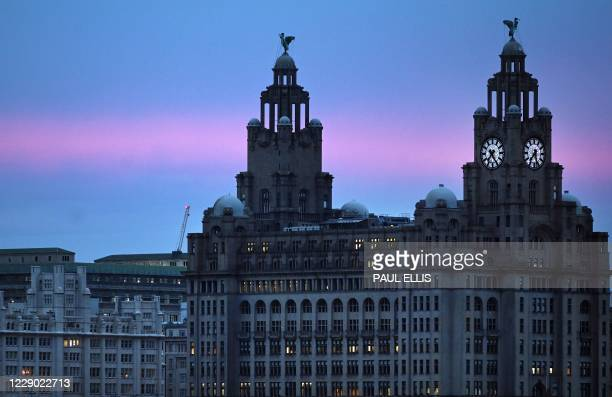 Sunrise over the Liver building in Liverpool on October 12, 2020 as the government is expected to announce further lockdown restrictions today as...