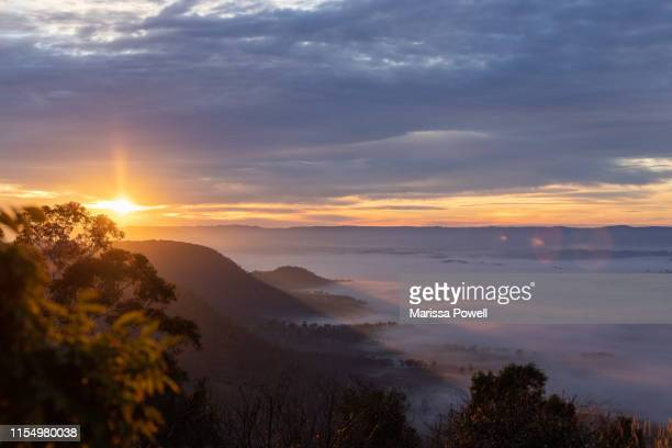 sunrise over the misty mountains - katoomba stock pictures, royalty-free photos & images