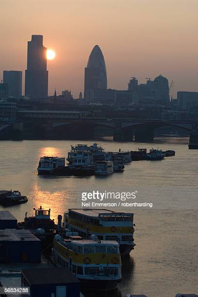 Sunrise over the Natwest Tower and Swiss Re Bank Building (the Gherkin), in the City of London, and River Thames, London, England, United Kingdom, Europe
