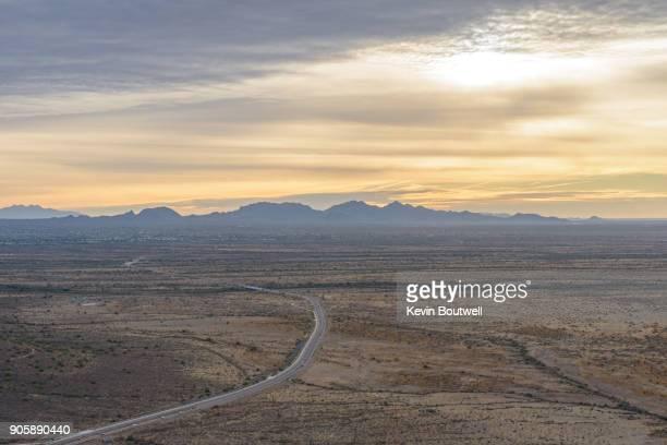 Sunrise over the North Phoenix desert with Dove Valley Rd and Soronan Desert Dr winding below