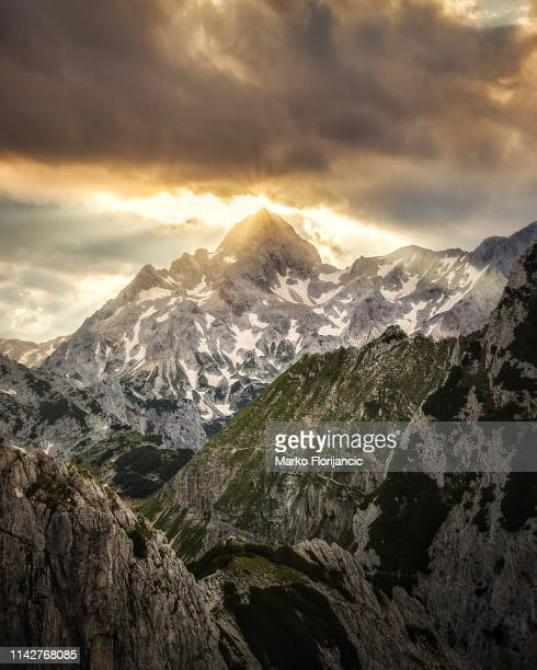 Sunrise over the peak of Triglav