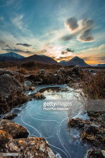 Sunrise over the Red Cuillin mountain range on the Isle of Skye, Scotland, on November 19, 2019. The Marsco peak is visible on the right side of the...