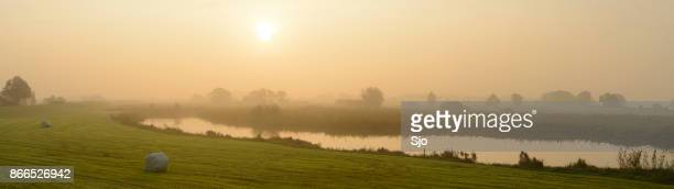 sunrise over the river ijssel during a beautiful fall morning - overijssel stock pictures, royalty-free photos & images