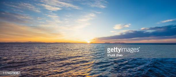 sunrise over the sea - horizon stock pictures, royalty-free photos & images