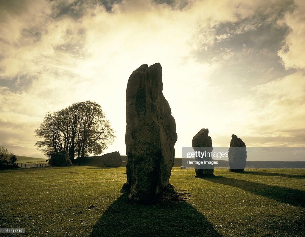 Sunrise over the stones, Avebury Stone Circle, Wiltshire, 1990.