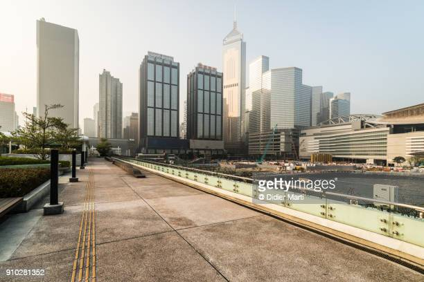 sunrise over the wan chai skyline in hong kong island - wanchai stock photos and pictures