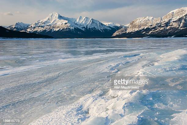 Sunrise over the wind blasted surface of Abraham Lake, Alberta, Canada