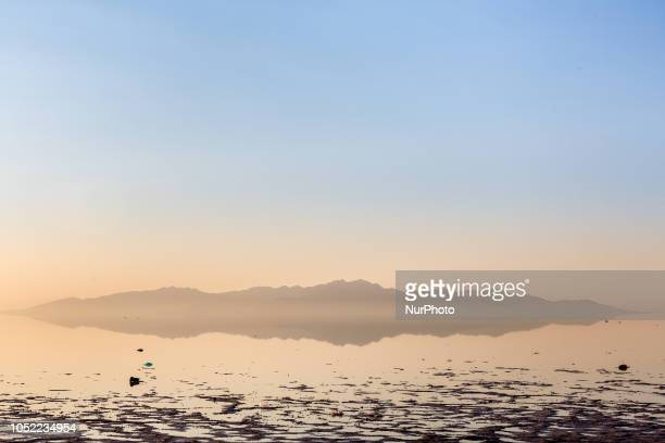 Sunrise over Urmia Lake in NorthWest region of Iran on September 26 2018 Urmia lake former tourist attraction and one of Earths wanders has shrunk...
