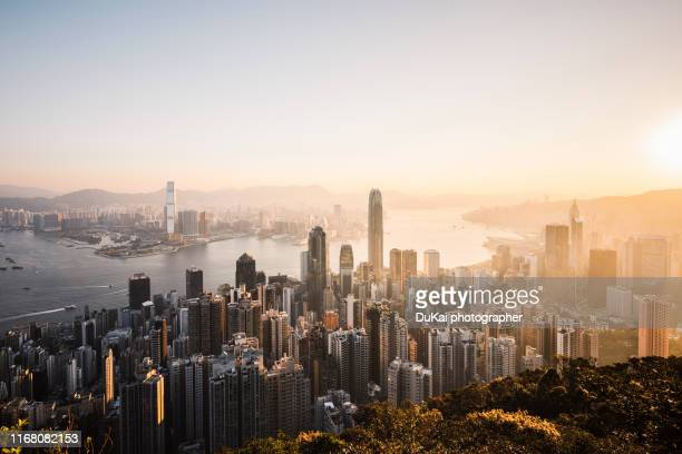sunrise over victoria harbor hong kong - hong kong stock pictures, royalty-free photos & images