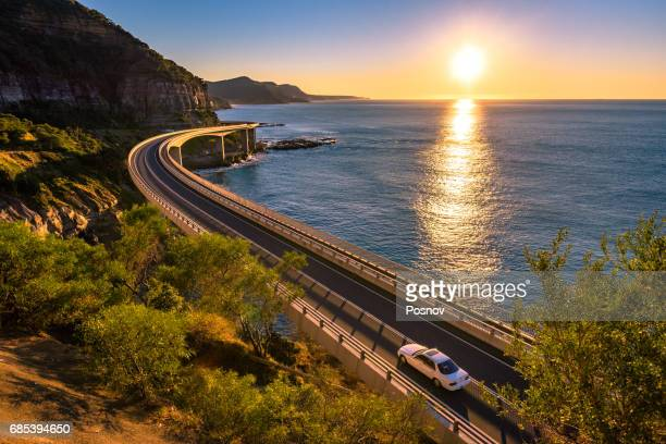 sunrise over wollongong sea cliff bridge, new south wales - new south wales stock pictures, royalty-free photos & images