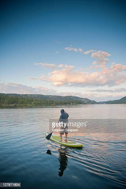 sunrise paddle board ride on the lake
