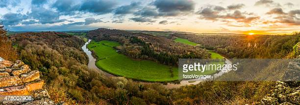 Sunrise panorama over idyllic meandering forest river valley Symonds Yat
