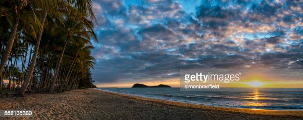 sunrise panoramic at palm cove, queensland, australia - cairns stock photos and pictures