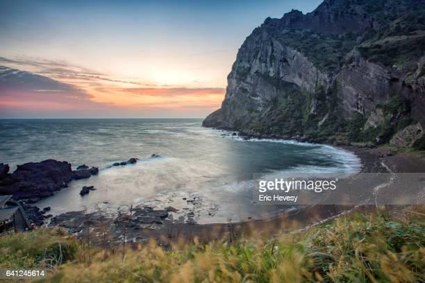 sunrise peak at sunrise, jeju island - jeju stock-fotos und bilder