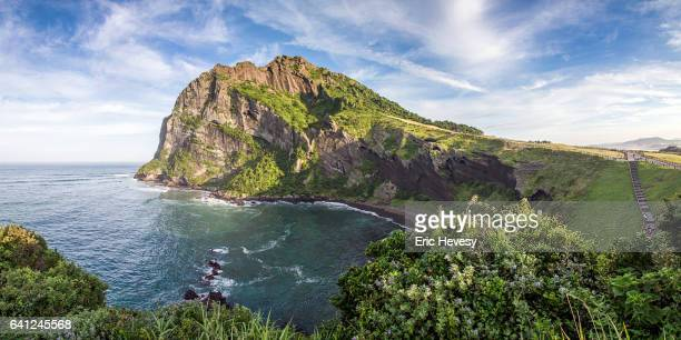 sunrise peak panorama, jeju island - jeju stock photos and pictures