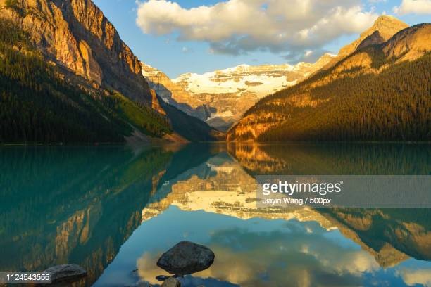 sunrise - chateau lake louise stock photos and pictures
