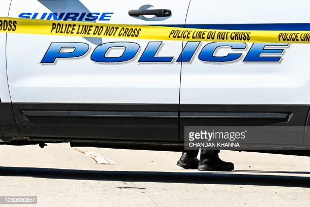 Sunrise Police block the street where two FBI agentry were killed and three others were injured in a shooting early February 2 as authorities were...