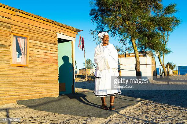 sunrise portrait of a sangoma outside het hut - xhosa culture stock photos and pictures