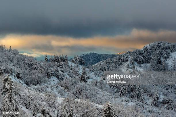 Sunrise reveals a snowy mountain scene as a Thanksgiving Day snowstorm clears in the San Gabriel Mountains near Los Angeles on November 28 2019 in...