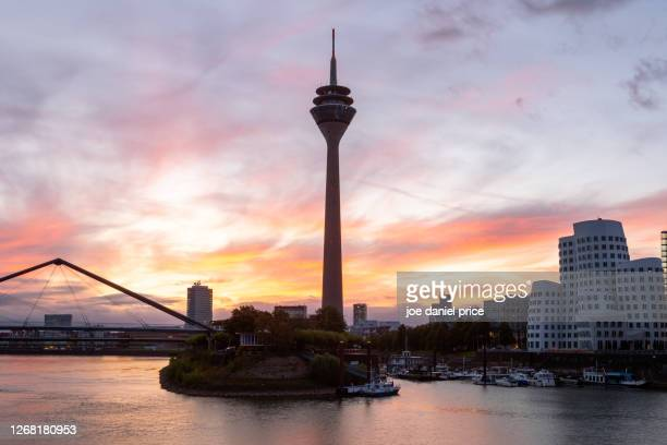 sunrise, rhine tower, dusseldorf, germany - messe düsseldorf stock pictures, royalty-free photos & images