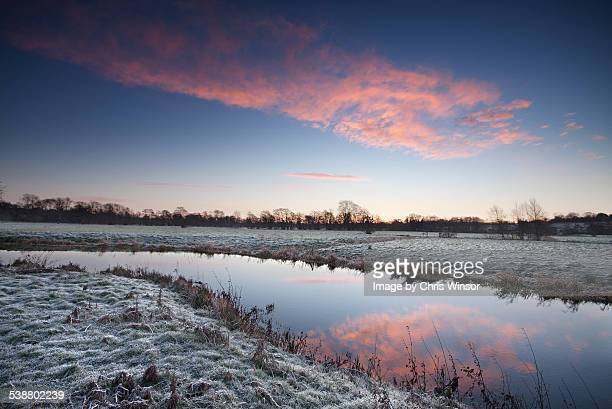 sunrise river reflection - suffolk england stock photos and pictures