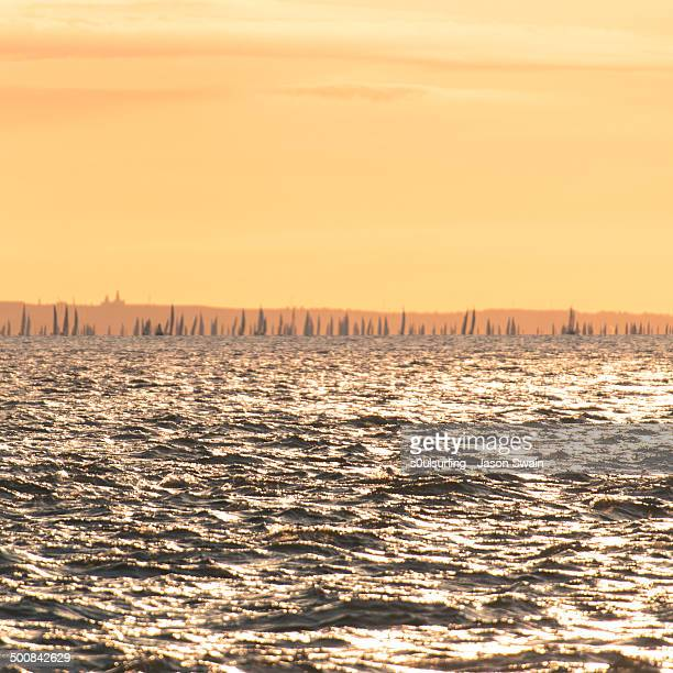 sunrise sailing on the isle of wight - s0ulsurfing stock pictures, royalty-free photos & images