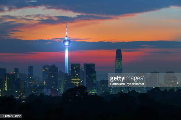 sunrise scence of kuala lumpur skyline with kl tower and petronas twin tower, malaysia - menara kuala lumpur tower stock photos and pictures