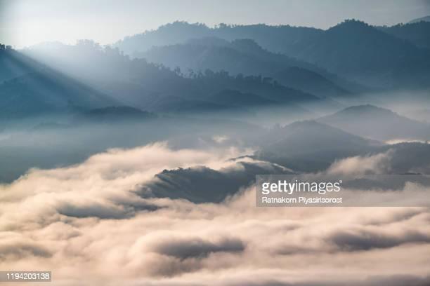 sunrise scene of mountain range and fog in yala province, thailand - mountain range ストックフォトと画像