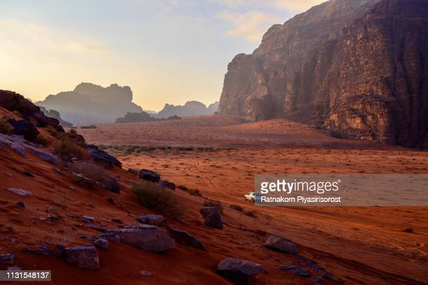 sunrise scene of red sand dune and amazing rock in wadi rum desert, jordan - eternity stock pictures, royalty-free photos & images