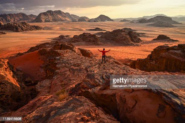 sunrise scene of red sand dune and amazing rock in wadi rum desert, jordan - non urban scene stock pictures, royalty-free photos & images