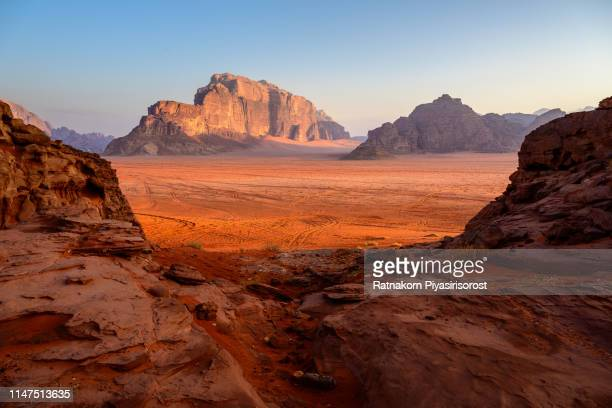 sunrise scene of red sand dune and amazing rock in wadi rum desert, jordan - granite stock pictures, royalty-free photos & images