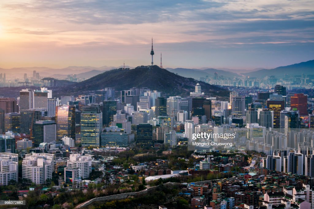 Sunrise scene of Seoul downtown city skyline, Aerial view of N Seoul Tower at Namsan Park in twilight sky in morning. The best viewpoint and trekking from inwangsan mountain in Seoul city, South Korea : Stock Photo