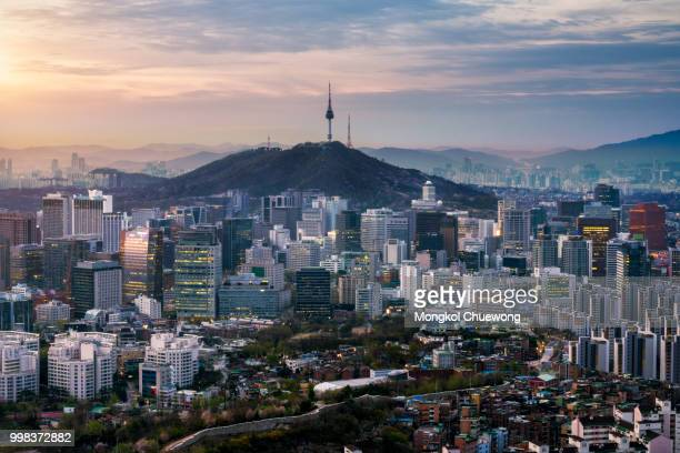sunrise scene of seoul downtown city skyline, aerial view of n seoul tower at namsan park in twilight sky in morning. the best viewpoint and trekking from inwangsan mountain in seoul city, south korea - south korea stock pictures, royalty-free photos & images