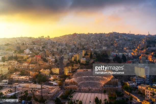 sunrise scene of the ancient roman amphitheater in amman, jordan - amman stock pictures, royalty-free photos & images