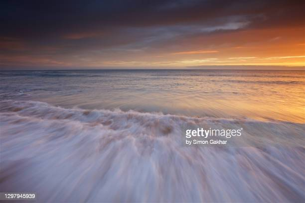 sunrise seascape photograph with water motion - seascape stock pictures, royalty-free photos & images