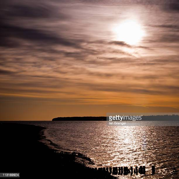 sunrise seascape - ian grainger stock pictures, royalty-free photos & images