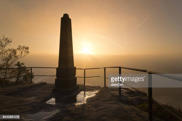 Sunrise seen from Lilienstein table mountain viewpoint with heavy fog in the Elbe valley, Saxon Switzerland National Park, Saxony, Germany