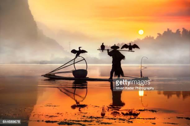 Sunrise Silhouette of Cormorant Fisherman, Yangshuo County, China