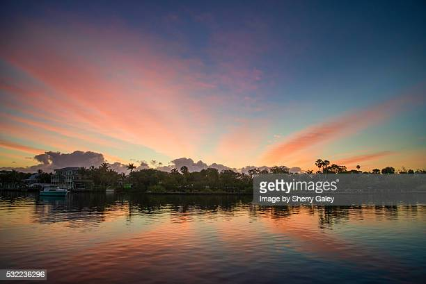 sunrise skies on the st. lucie river, florida - stuart florida stock pictures, royalty-free photos & images